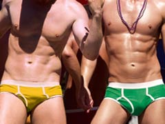 Two Gay Match Maker members wearing colourful underwear in the sun